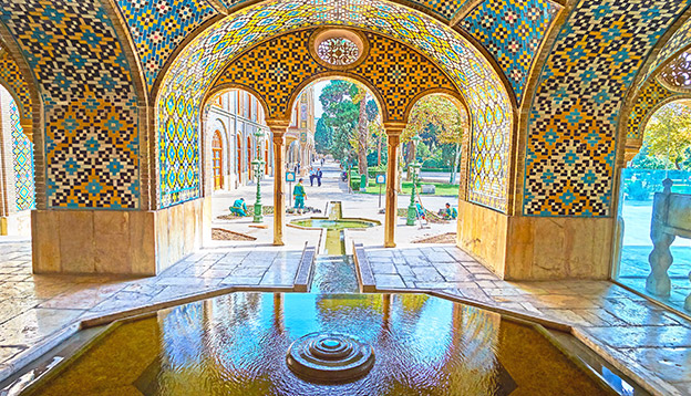 TEHRAN, IRAN - OCTOBER 11, 2017: The fountain in Karim Khani Nook of Golestan was created to provide freshness and coolness to this summer pavilion, on October 11 in Tehran. Photo Credit: Shutterstock.