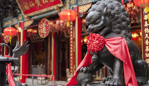 Chinese Lion statue in Wong Tai Sin Temple in Hong Kong. Photo Credit: Shutterstock.