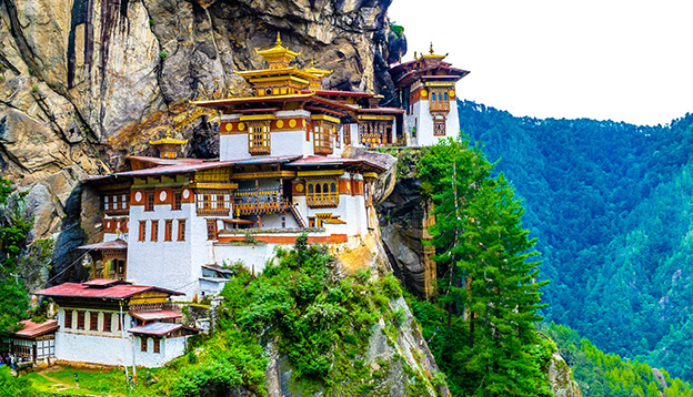 Taktshang Goemba(Tiger's Nest Monastery), Monastery, Bhutan, in a mountain cliff. Photo Credit: Shutterstock