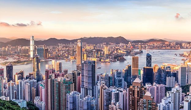 Sunset over Victoria Harbor as viewed atop Victoria Peak. Photo Credit: Shutterstock.