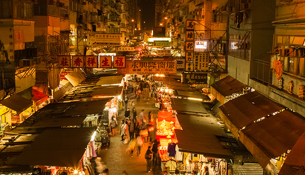 In the night streets of Hong Kong, China. Photo Credit: Shutterstock.