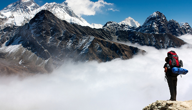 View of Everest from Gokyo Ri with tourist on the way to Everest base camp - Nepal. Photo Credit: Shutterstock