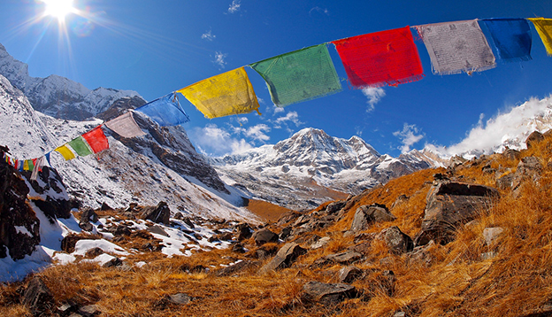 Tibetan Flags at Annapurna Base Camp 4200m (Himalaya, Nepal). Photo Credit: Shutterstock