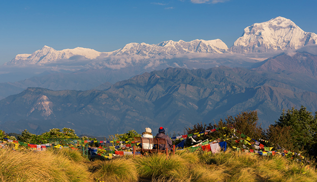 Couple watching the Mt. Dhaulagiri (8,172m) from Poon Hill, Nepal. Photo Credit: Shutterstock