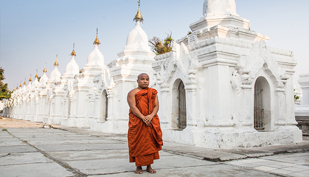 Monk in traditional clothing. Photo Credit: Luke Ballard