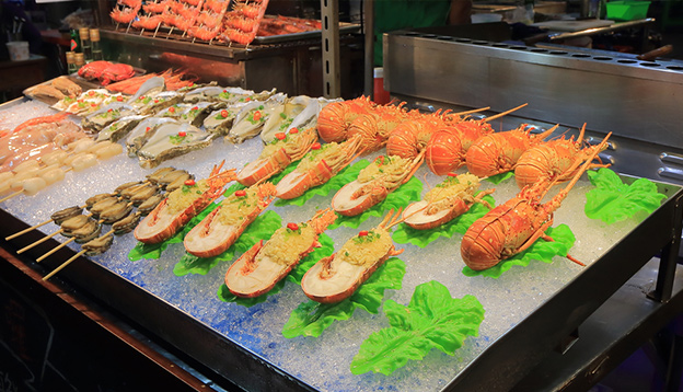 Liuhe night street market seafood shop. Liuhe market is one of the most popular markets in Taiwan. Photo Credit: Shutterstock